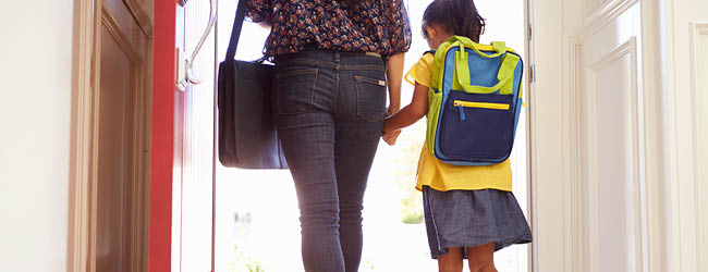 Mom holding child's hand, leaving home for work and school